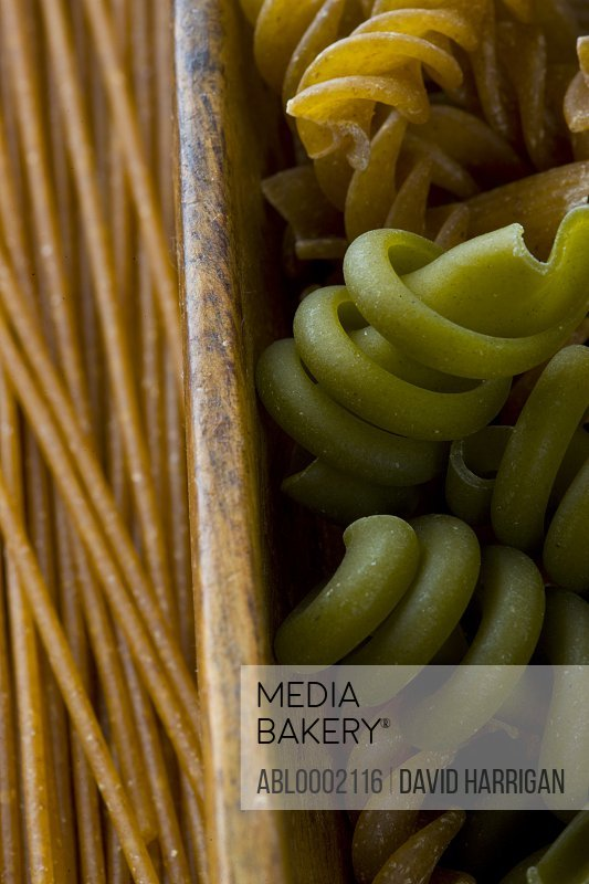 Green and Whole Wheat Pasta in Wooden Drawer