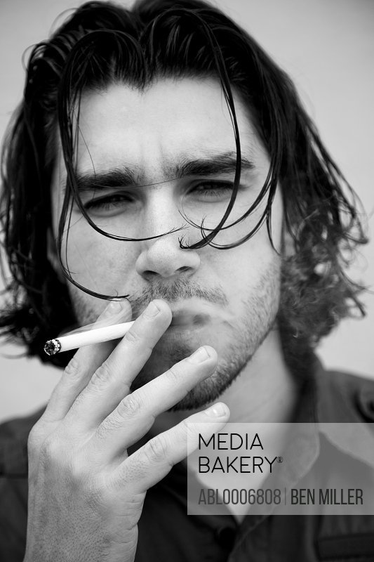 Man Smoking Cigarette, Close-up view