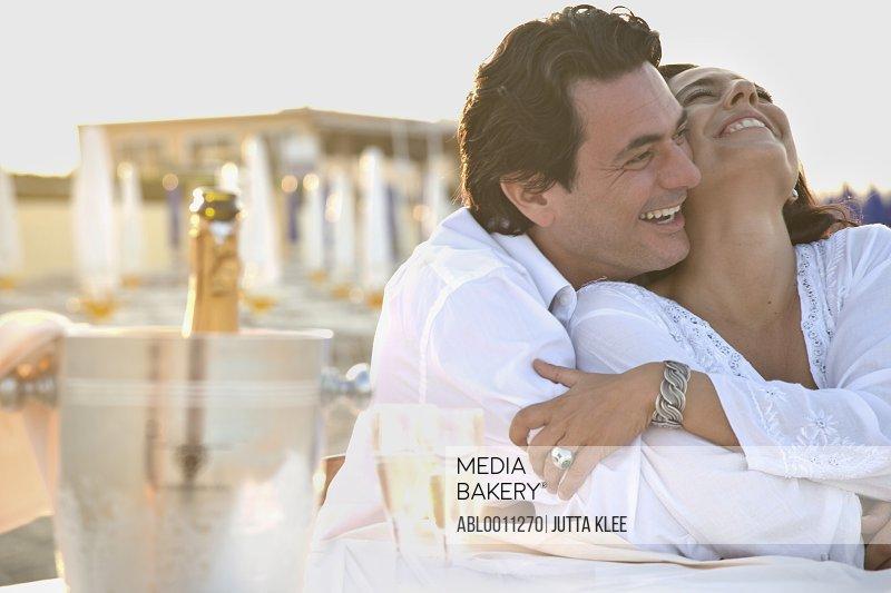 Couple on Beach Hugging