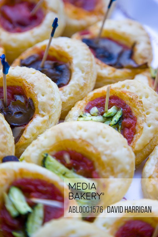 Close up of assorted mini pizzas