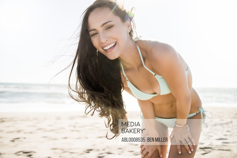 Smiling Young Woman on Beach