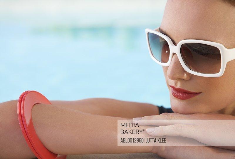 Close up Portrait of a woman wearing sunglasses