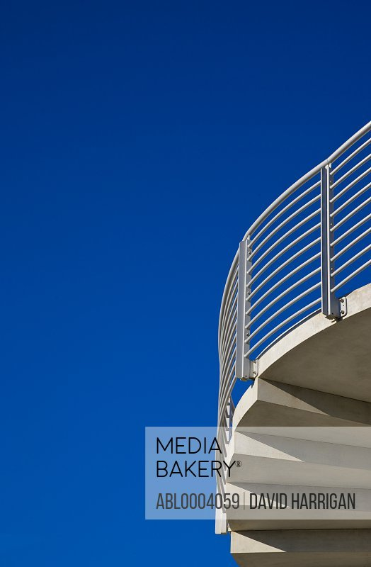 Detail of a concrete staircase against a cloudless blue sky