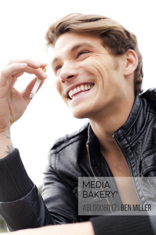 Smiling Man Smoking Cigarette