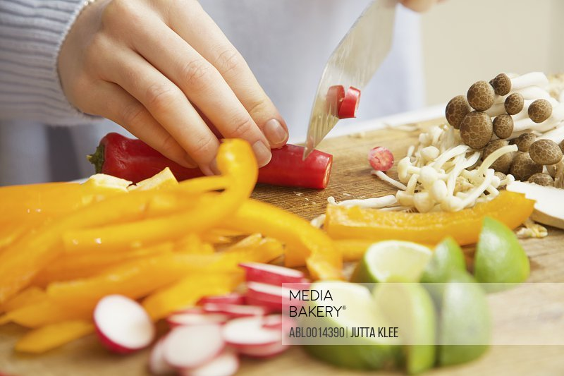 Woman Chopping Vegetables with Knife, Close-up view