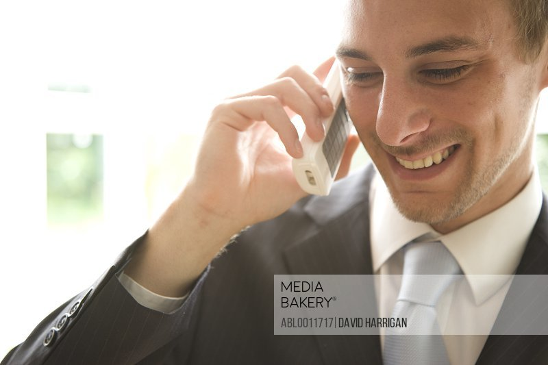 Close up of young businessman talking on the phone