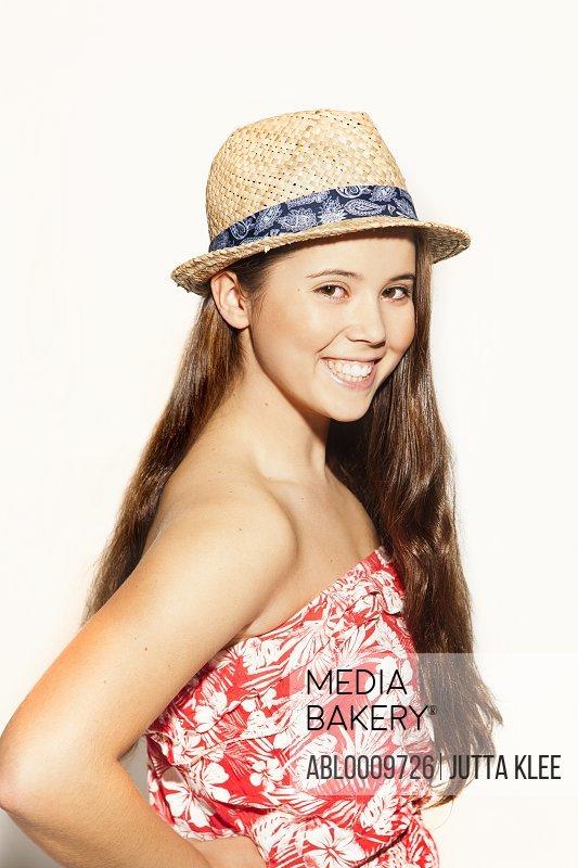 Teenage Girl Wearing Straw Hat Smiling