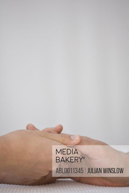 Close up of manicurist's hands massaging man hand