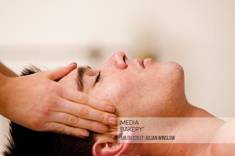 Man receiving a head massage