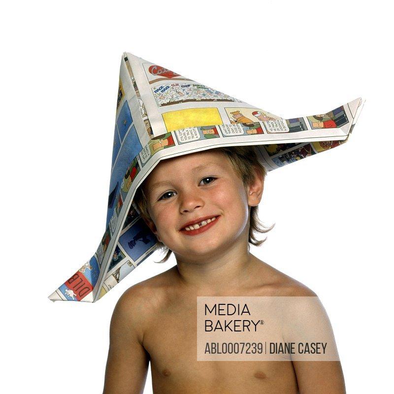 Boy Wearing Newspaper Hat Smiling