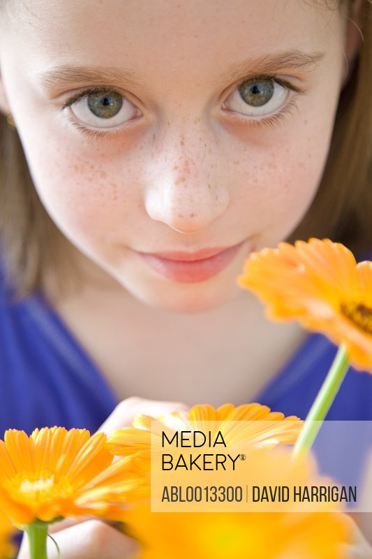Young Girl Holding Orange Flowers