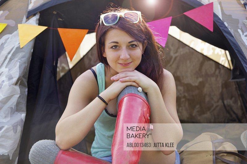 Teenage Girl Sitting Outside Tent