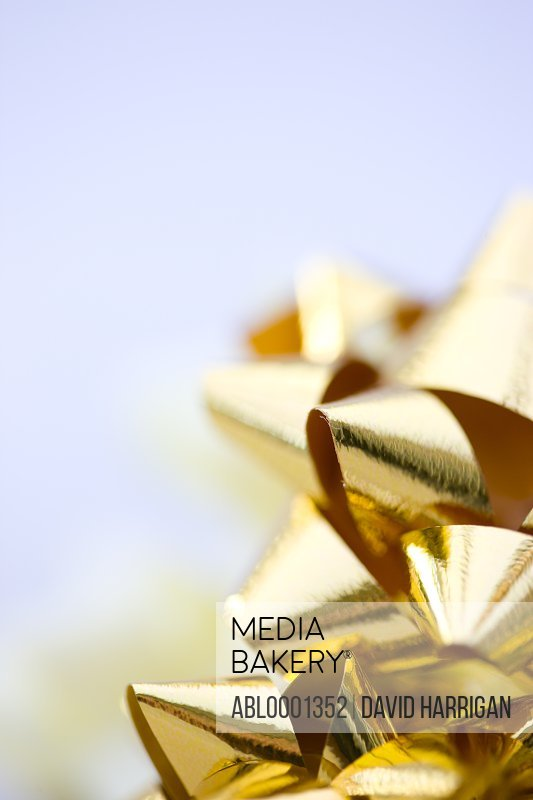 Close up of gold bows