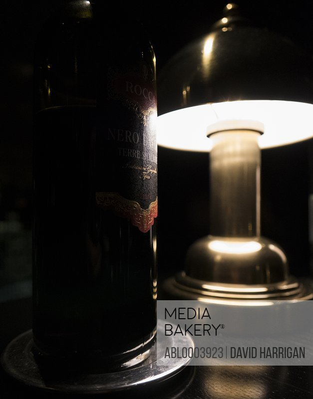 Wine Bottle and Table Lamp, Close-up view