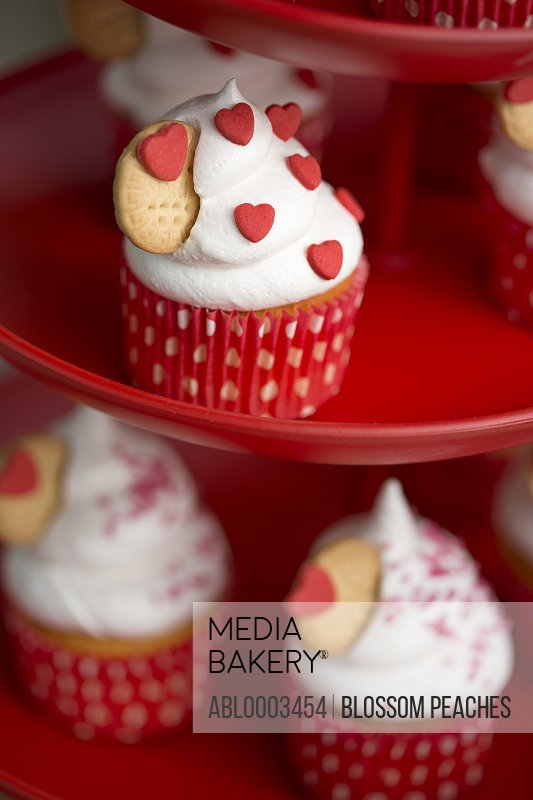 Fresh Cream Cupcakes Decorated with Red Heart Shaped Candies