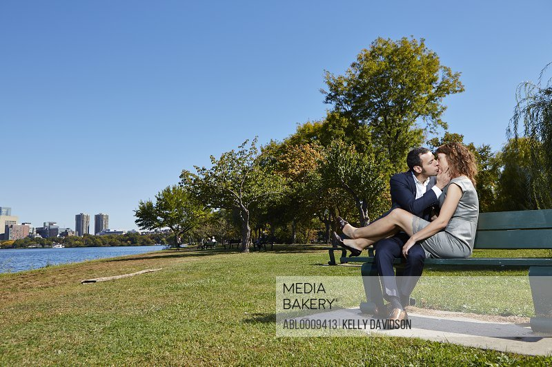 Couple Kissing on Park Bench