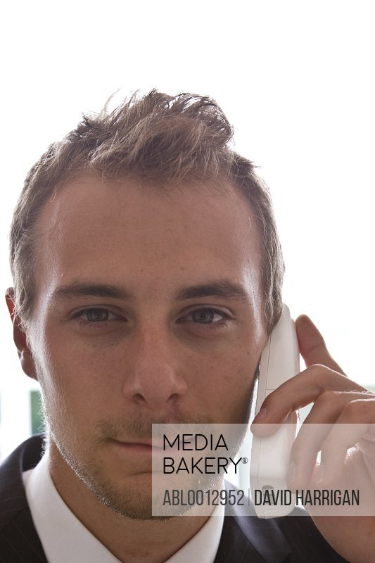 Close up of a young businessman talking on the phone