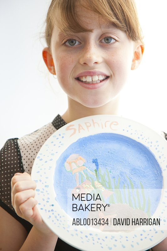 Girl Holding Hand Painted Plates
