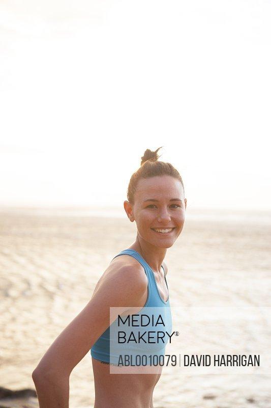 Woman on Beach in Blue Sport Bra