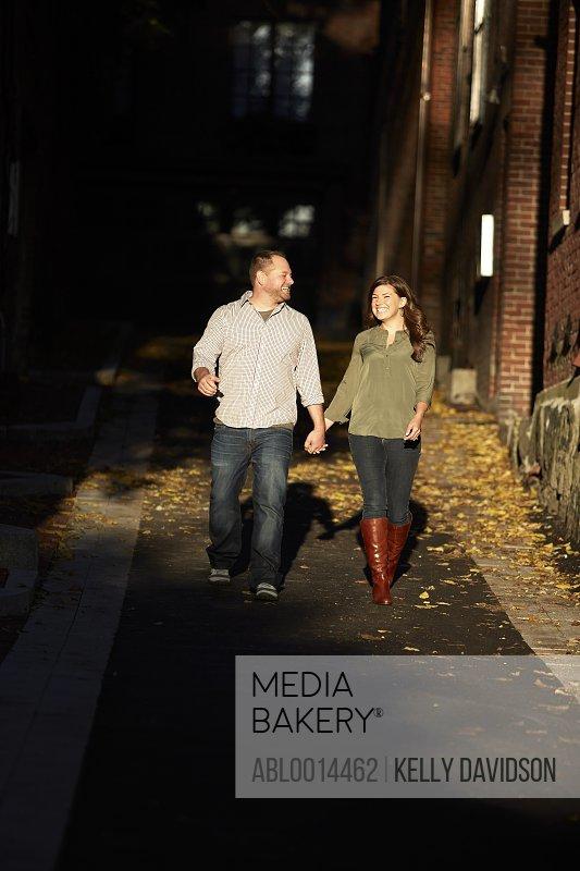 Couple Walking on Street Smiling