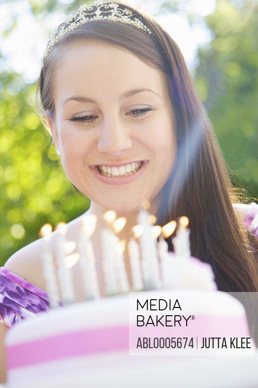 Girl and birthday cake
