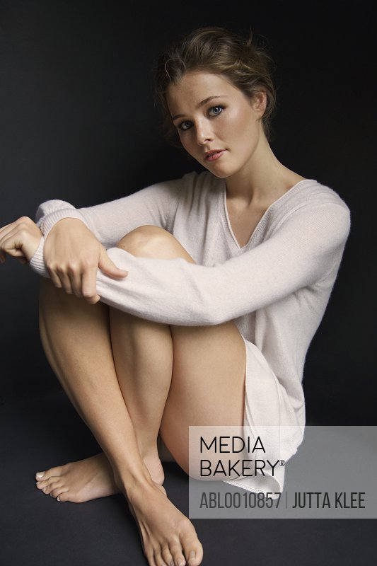 Young Woman Hugging her Knees