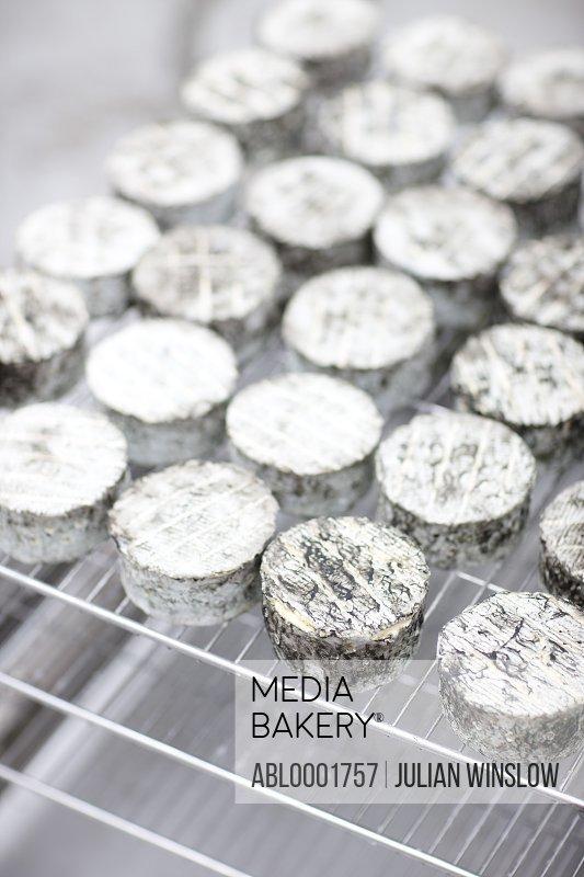 Cheeses maturing