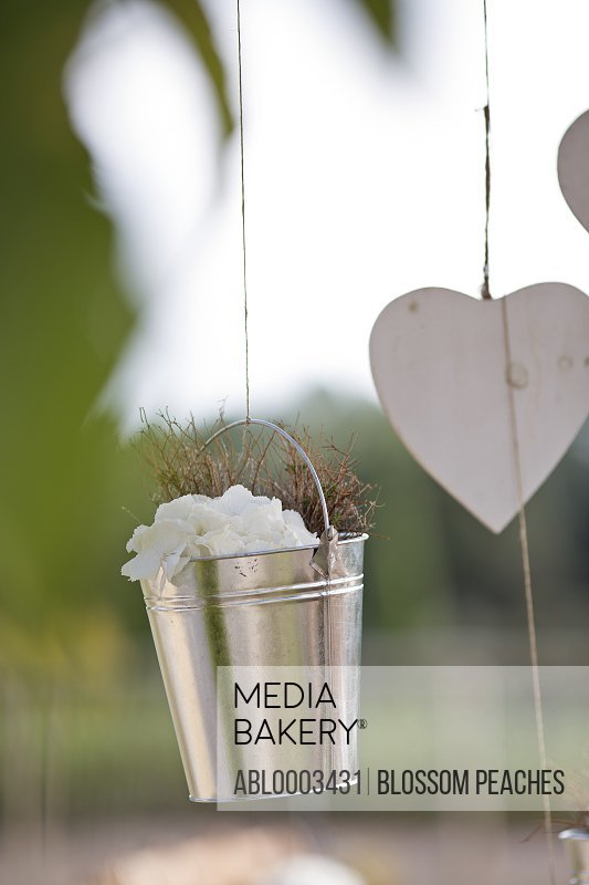 Flower Bucket and Heart Shaped  Decoration at Outdoor Wedding Ceremony