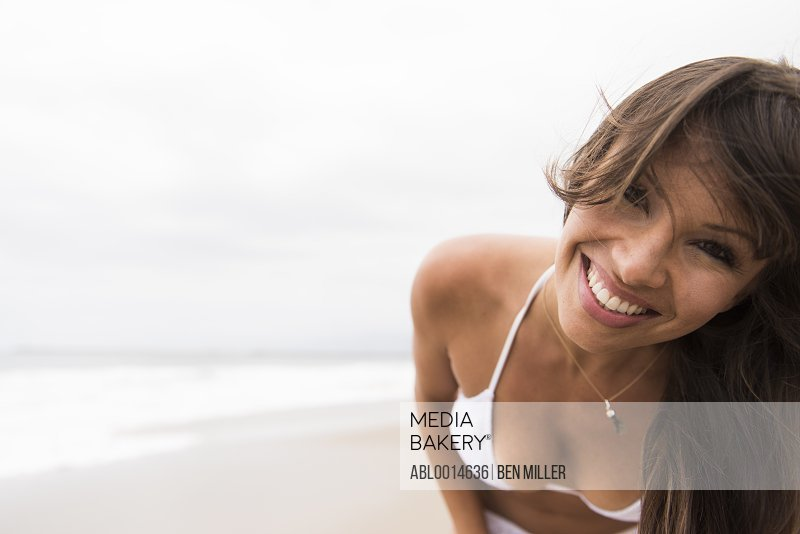Close up of Woman on Beach Smiling