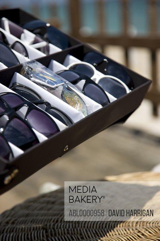 Box of sunglasses for sale