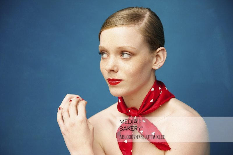 Young Woman with Red Scarf around Neck