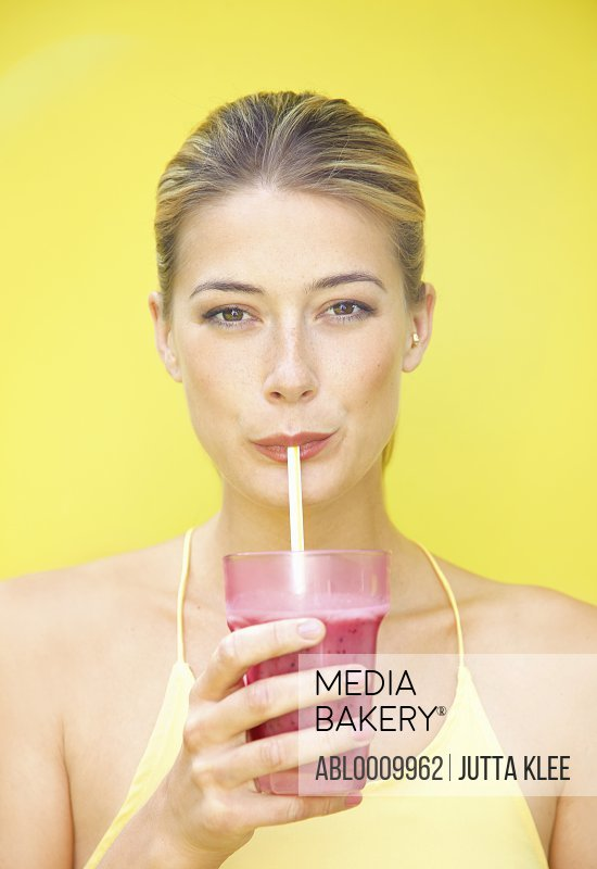Woman Drinking Smoothie with Straw