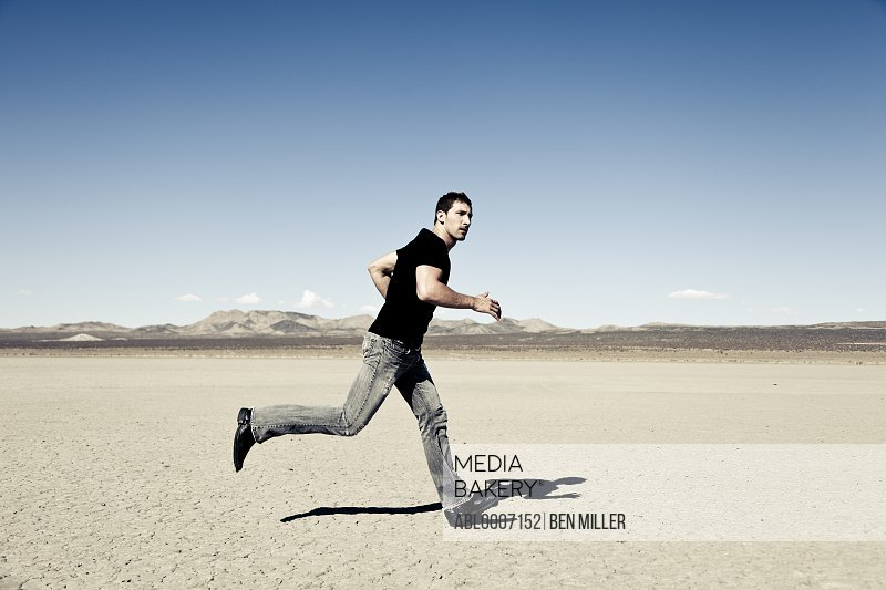 Man Running in Desert Landscape