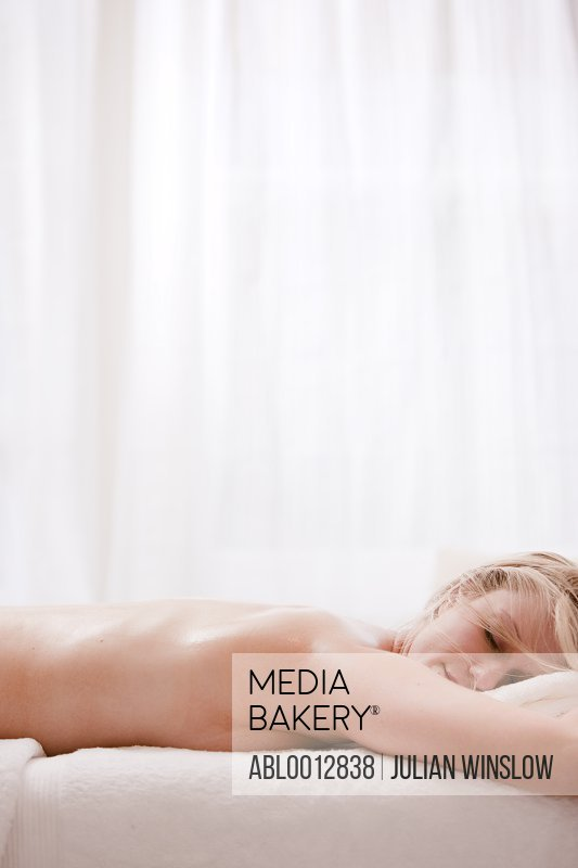 Profile of a woman lying on her stomach on a massage table