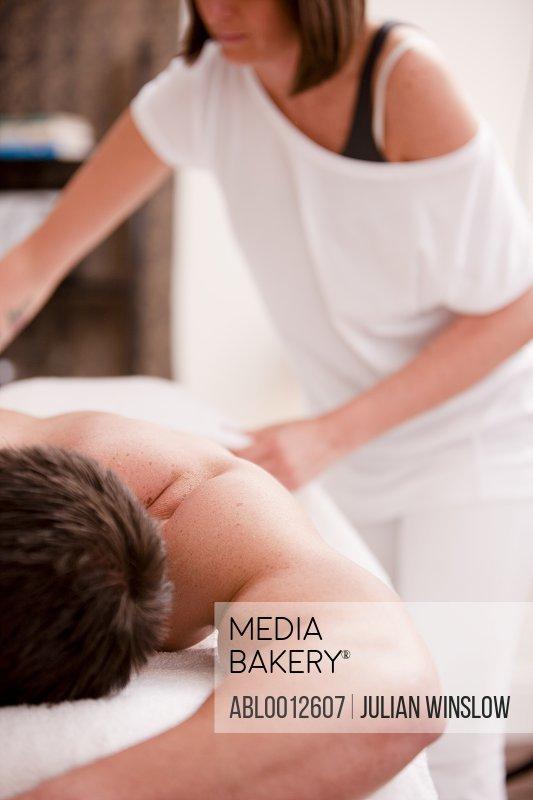 Masseuse preparing to massage a man