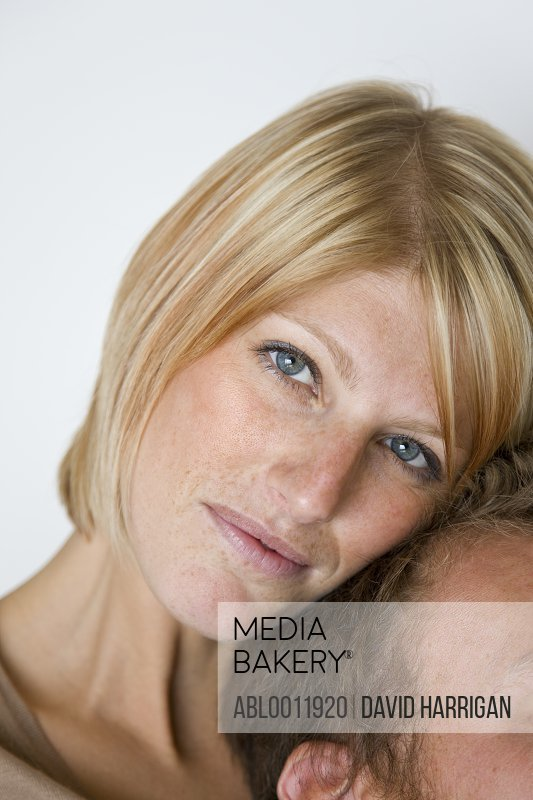 Extreme close up of woman leaning against man head
