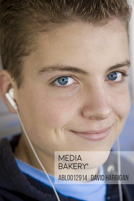 Close up of a boy wearing earphones