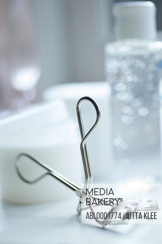 Close up of a silver eyelash curler