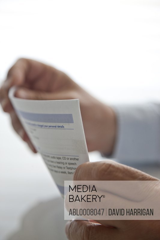 Man's Hands Holding Document