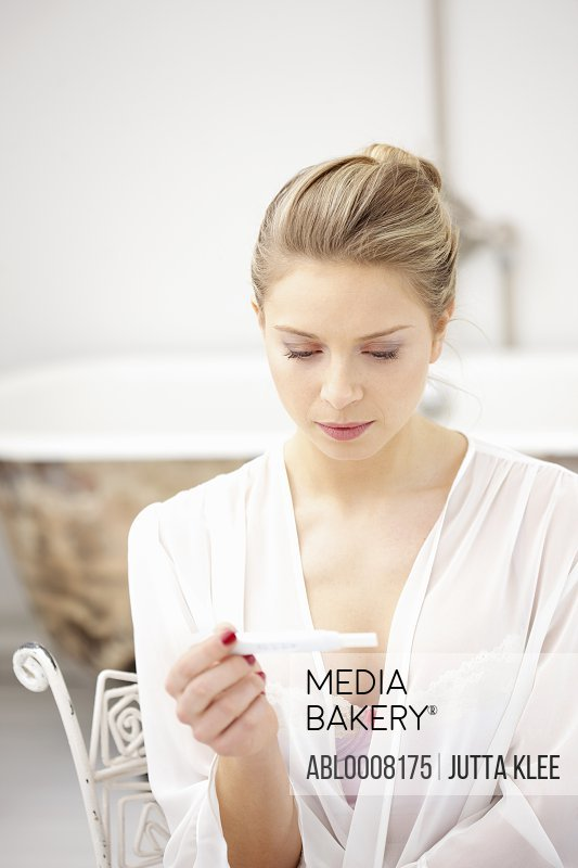 Woman Reading Pregnancy Test