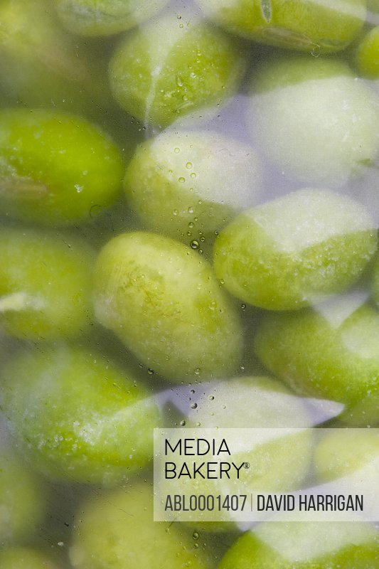 Extreme close up of a freezer bag filled with frozen edamame beans