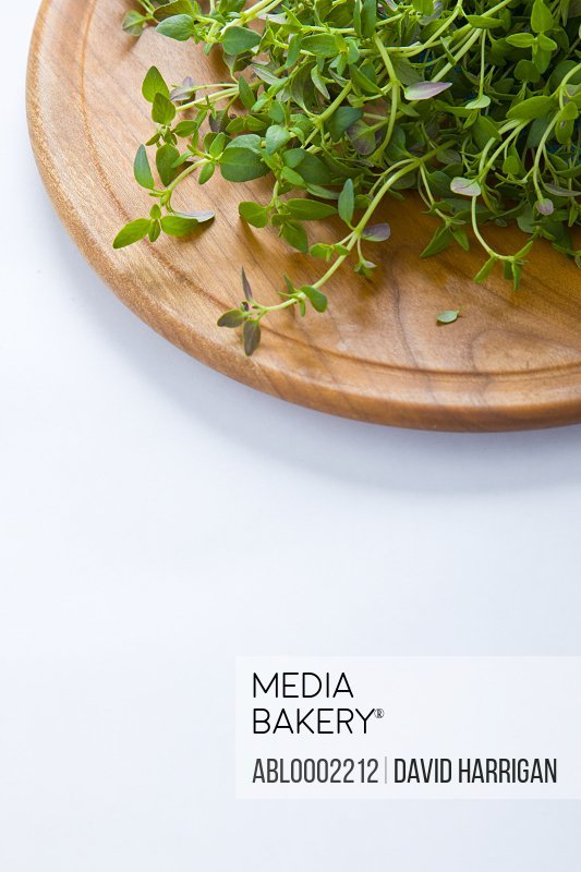 Thyme Leaves on Wooden Cutting Board