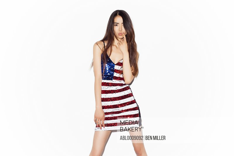 Young Woman Wearing American Flag Sequins Dress