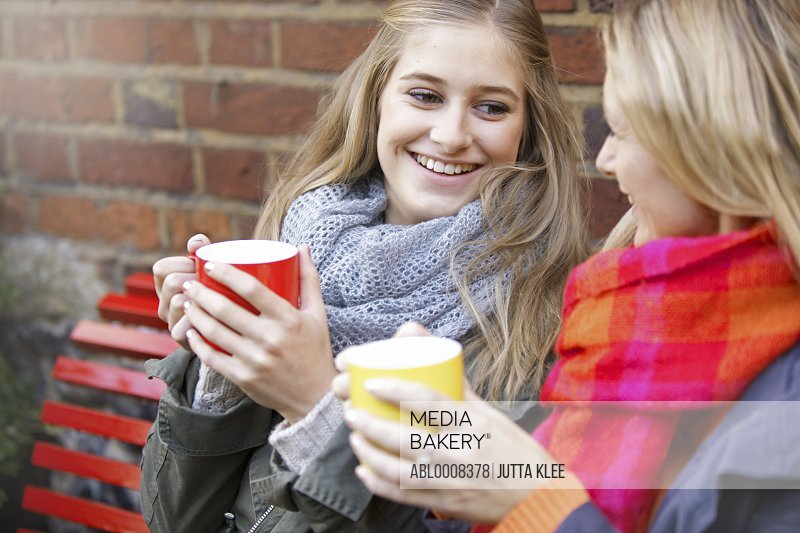 Mother and Daughter Having Hot Drinks Outdoors