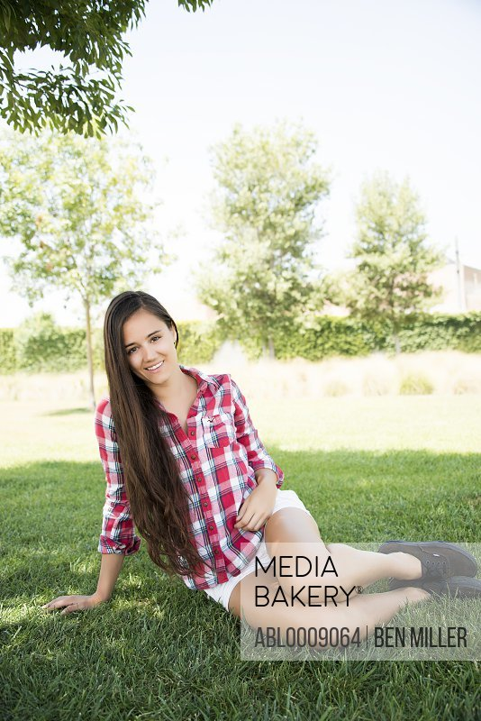 Young Woman Sitting in Park