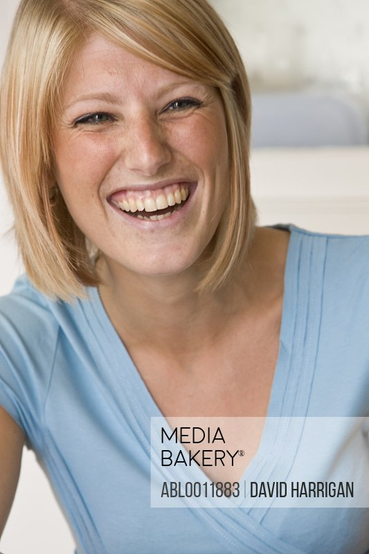 Portrait of a young blonde woman laughing