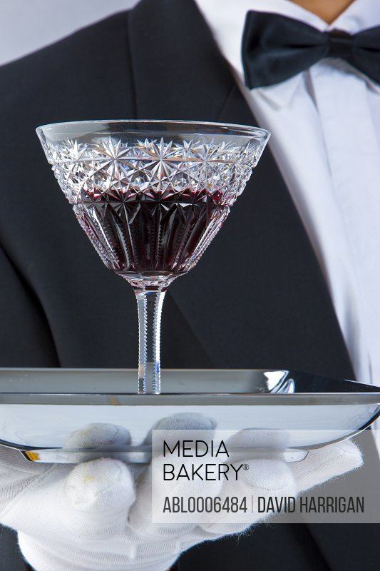 Waiter's Gloved Hand Holding Tray with Glass of Port