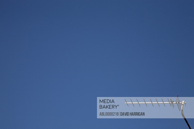 Television aerial against cloudless blue sky
