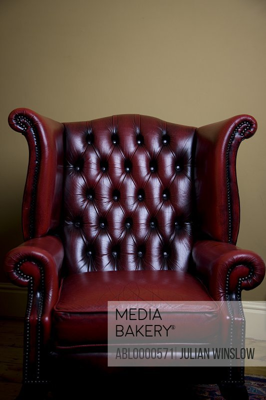 Red leather chesterfield armchair