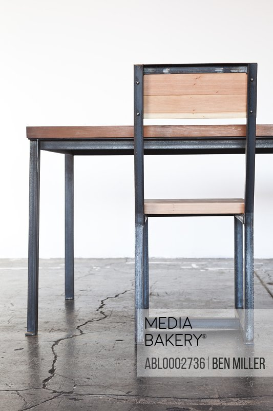 Iron Frame Wooden Table and Chair on Concrete Floor
